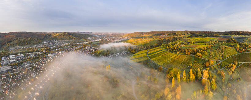 Germany, Baden Wurttemberg, Remstal, Drone view of countryside town at foggy dawn - STSF02661