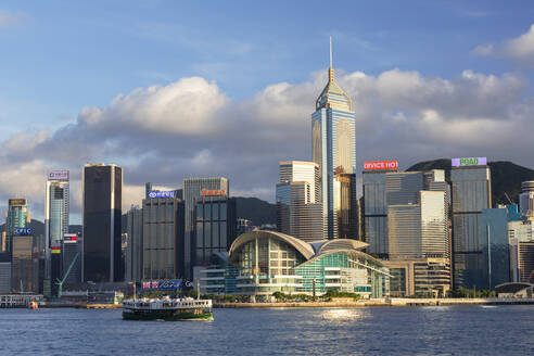 Star Ferry in Victoria Harbour with skyscrapers of Wan Chai, Hong Kong, China, Asia - RHPLF18240