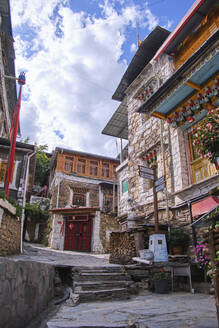 From below of stone and wooden building of local street in ancient Sichuan province - ADSF18319