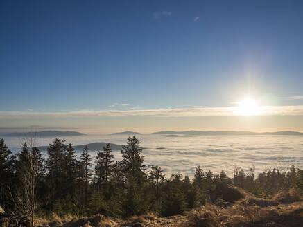 Sun setting over foggy landscape seen from summit of Heugstatt mountain - HUSF00146