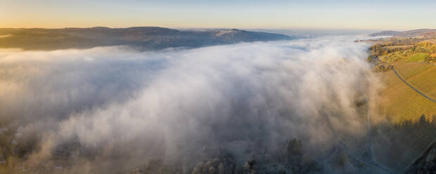 Germany, Baden-Wurttemberg, Drone view of Remstal valley shrouded in thick fog at sunrise - STSF02709