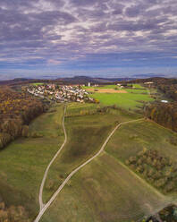 Germany, Baden-Wurttemberg, Drone view of village inRemstal valley at autumn dawn - STSF02715