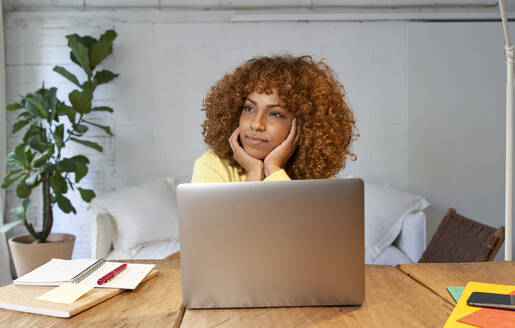 Young businesswoman day dreaming while working from home - VEGF03312