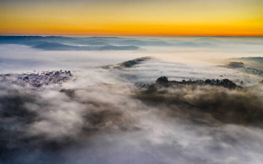 Germany, Baden-Wurttemberg, Berglen, Drone view of village shrouded in thick fog at dawn - STSF02734