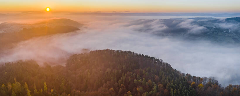 Drone view of Remstal valley shrouded in thick fog at sunrise - STSF02740