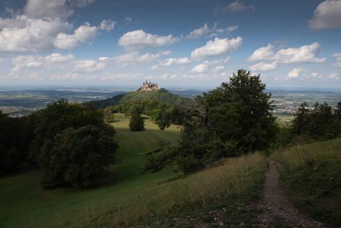 Burg Hohenzollern on mountain peak against sky at Swabian Alb, Germany - FDF00334