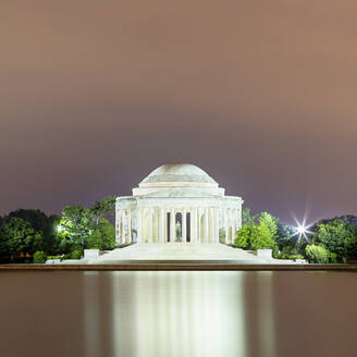 USA, Washington DC, Jefferson Memorial reflecting in Tidal Basin at dusk - AHF00246