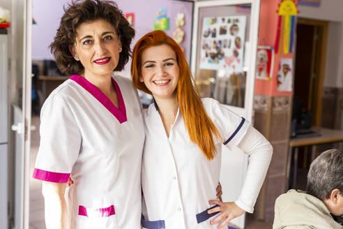 Smiling female nurses in nursing home - LJF02006