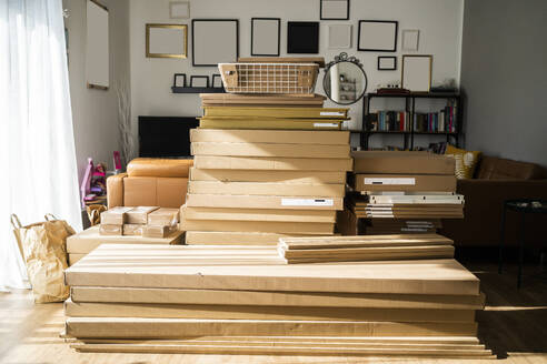 Waste cardboard boxes stack in living room - GIOF10254
