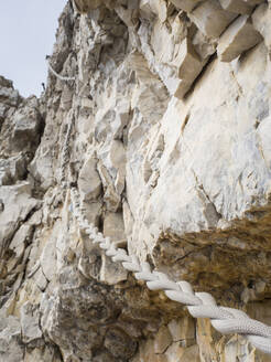 Rope hanging from steep cliff in Sexten Dolomites - HUSF00166