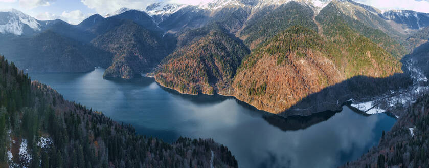Aerial view of Lake Ritsa surrounded by forested mountains in autumn - KNTF06050