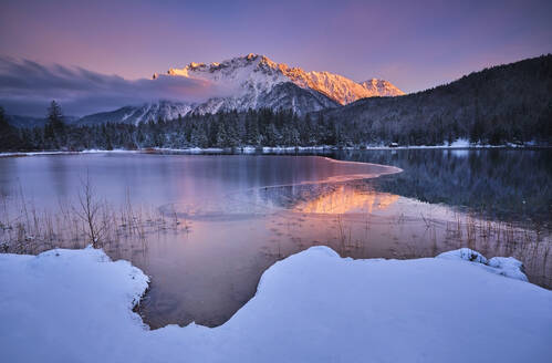 Scenic view of Lautersee lake with Karwendel mountain during sunset - MRF02420