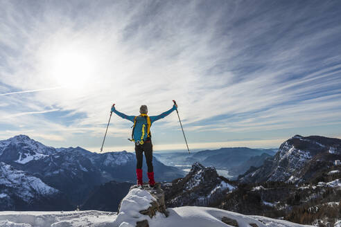 Carefree hiker with arms outstretched standing on mountain, Orobic alps, Lecco, Italy - MCVF00701