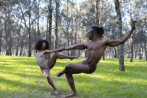 Two professional dancers performing in underwear in middle of forest - JCCMF00591