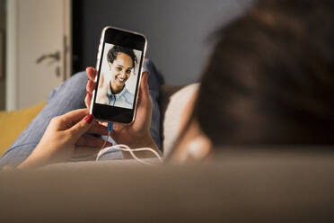 Multi ethnic female friends on video call through mobile phone - UUF22393