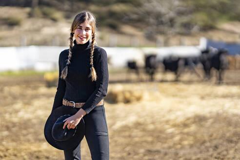 Portrait of female rancher in field - GGGF00781