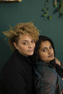 Portrait of lesbian couple sitting together - AXHF00085