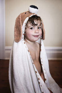 Smiling boy after bath wearing dog towel - ISPF00018