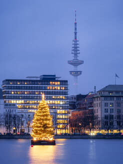 Germany, Hamburg, Inner Alster, Heinrich Hertz Tower, Lake and city view with Christmas decorations - RJF00848