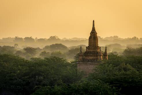 Pagoda against clear orange sky during sunrise, UNESCO, Bagan, Myanmar - CAVF91804