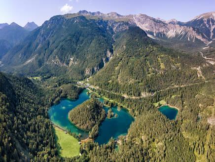 Austria, Tyrol, Lake Samerangersee, Lake Fernsteinsee Aerial view of lake and mountains - YRF00270