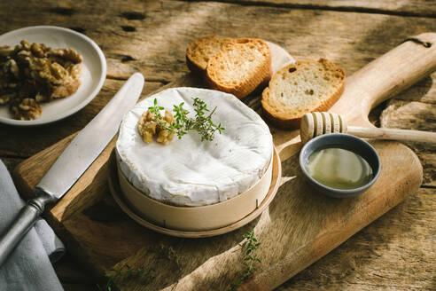 Baked camembert served on wooden table - ADSF20432