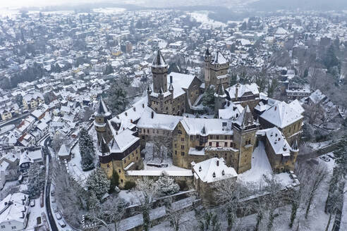 Germany, Hesse, Braunfels, Helicopter view of Braunfels Castle and surrounding town in winter - AMF09055