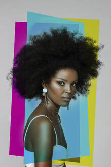 Attractive Afro woman with primary colors against white background - EIF00362