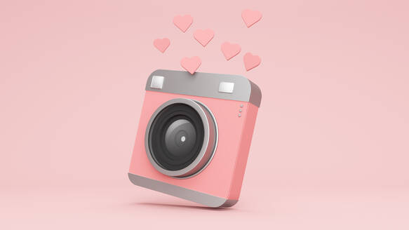 Three dimensional render of hearts floating over old-fashionedcamera - JPSF00042