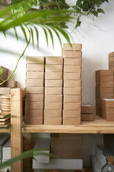 Stack of packed boxes over table at workshop - VEGF03991