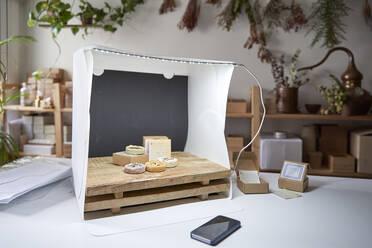 Soaps arranged in lightbox on table at workshop - VEGF04006