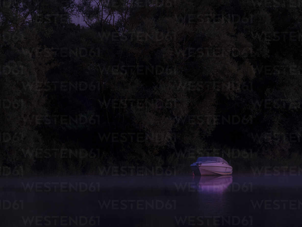 Lone motorboat floating in Saone river at purple night - HAMF00843 - Hans Mitterer/Westend61