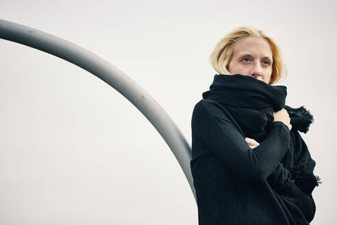 Blond woman with scarf against clear sky - UKOF00139