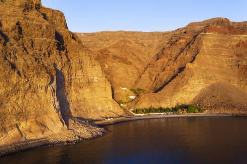 Spain, Valle Gran Rey, Drone view of Barranco de Argaga gorge and Playa de Argaga beach at dusk - SIEF10103