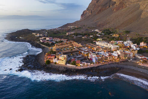 Spain, Valle Gran Rey, Drone view of town at edge of La Gomera island at dusk - SIEF10106