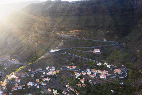 Spain, Valle Gran Rey, Drone view of village and winding road in valley of La Gomera - SIEF10109