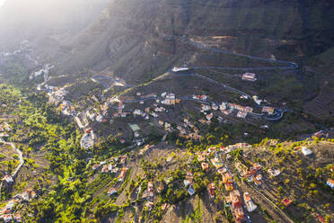 Spain, Valle Gran Rey, Drone view of village and winding road in valley of La Gomera - SIEF10112
