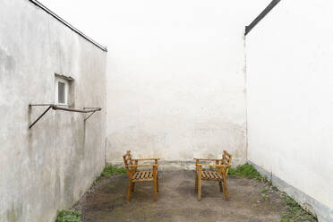 Empty chairs in yard - DRF01761