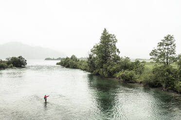 Male fisherman fishing whiles standing in Loisach river at Kochelsee, Bavaria, Germany - WFF00452