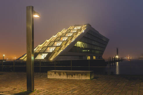 Germany, Hamburg, Altona, Dockland office building in fog  - KEBF01784