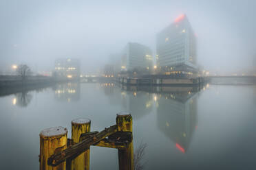 Germany, Hamburg, City architecture in fog - KEBF01805