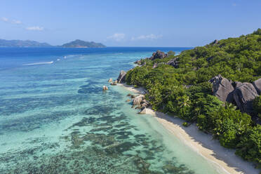 Aerial view of the famous sandy beach Anse Source d´Argent at La Digue Island in distant is Praslin Island. Anse Source d´Argent, La Digue, Praslin, Seychelles, Indian Ocean, Indian Ocean Islands, Africa, Equator. - RUEF03191