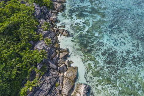Drone view of granite rock formations of Anse Source DArgent beach in summer - RUEF03197