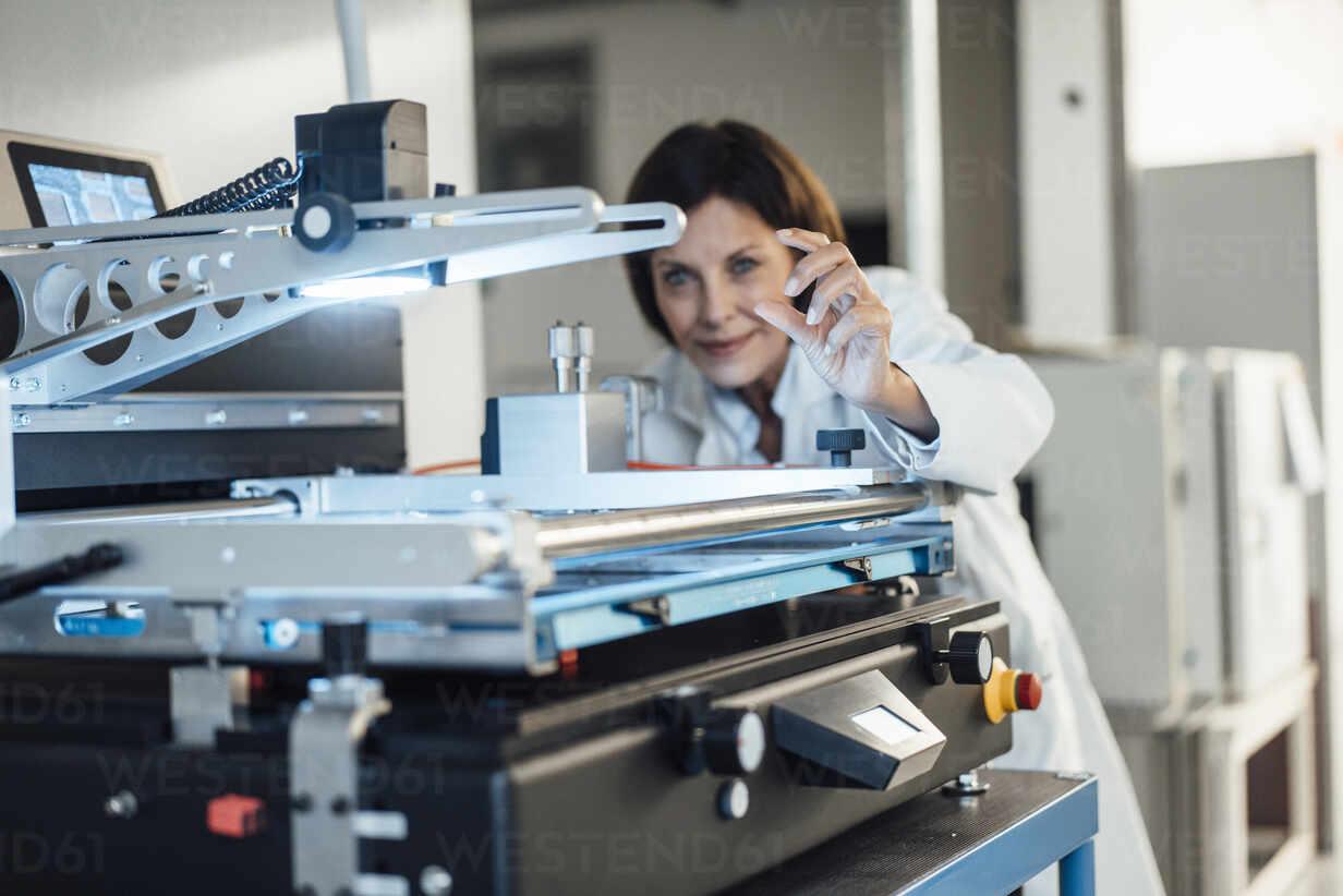 Mature female technician analyzing machinery at industry - JOSEF03749 - Joseffson/Westend61
