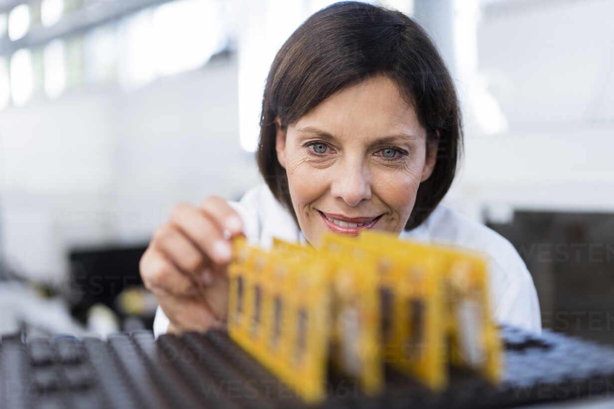 Female engineer examining equipment in industry - JOSEF03872 - Joseffson/Westend61
