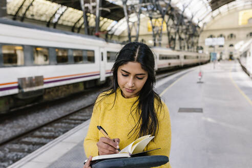 Barcelona, Catalonia, Spain - Indian woman standing in the train station - XLGF01231